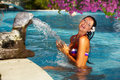 Woman in swimming pool Stock Images