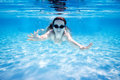 Woman swimming underwater Stock Photo