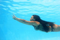 Woman swimming underwater Royalty Free Stock Image