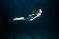 Woman swims underwater. Royalty Free Stock Photo