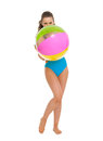 Woman in swimsuit hiding behind beach ball full length portrait of young Royalty Free Stock Photography