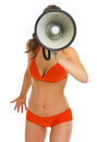 Woman in swimsuit shouting through megaphone isolated on white Stock Images