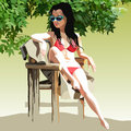 Woman in a swimsuit sunbathing in a chair in the nature Royalty Free Stock Photo