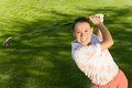 Woman Swinging Golf Club Royalty Free Stock Photos