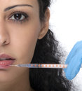 Woman with syringe treatment botox or hyaluronic collagen ha injection Royalty Free Stock Photos