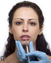Woman with syringe treatment botox or hyaluronic collagen ha injection Stock Photography