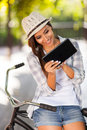 Woman tablet outdoors cheerful young using computer Stock Images