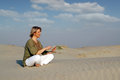 Woman with tablet pc in the desert beautiful Royalty Free Stock Images