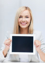 Woman with tablet pc picture of smiling showing display Royalty Free Stock Photography