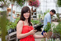 Woman with tablet pc and potted plant Stock Photo