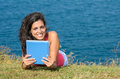 Woman with tablet on vacations in summer Stock Photography