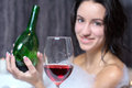 Woman takes bath a beautiful in a with foam drinking wine Stock Photos