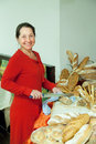 Woman takes fresh bread Royalty Free Stock Photography
