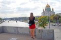 A woman takes photos of moscow city september christ the saviors church popular touristic landmark in Royalty Free Stock Photography