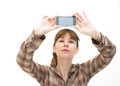 Woman takes a picture with a phone Stock Photography