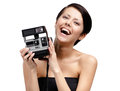 Woman takes snaps with cassette photographic camera isolated on white Royalty Free Stock Photography