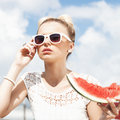 Woman takes watermelon concept of healthy and dieting food young from the opened fridge full vegetables fruit Stock Images