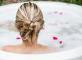 Woman taking a bubble bath Royalty Free Stock Photo