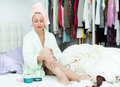 Woman taking care of leg happy skin after shower Stock Image