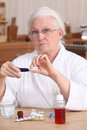 Woman taking her medication elderly Royalty Free Stock Photo