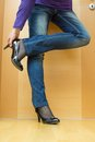 Woman taking her shoes off after a long day Royalty Free Stock Image