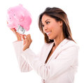 Woman taking money from a piggybank business out isolated over white Royalty Free Stock Image