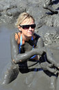 Woman taking a mud bath  Stock Photography