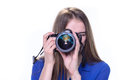 Woman taking a photo with a camera Royalty Free Stock Photo