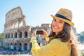 Woman taking photo of colosseum in rome, italy Royalty Free Stock Photo