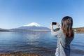 Woman taking photo on Fujisan Royalty Free Stock Photo