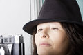Woman taking a photo with hat takes photos with old camera Stock Photography