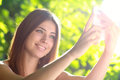 Woman taking photo of herself beautiful young with her mobile phone soft summer colors Royalty Free Stock Image