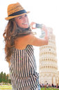 Woman taking photo of leaning tower of pisa, tusca Royalty Free Stock Photo