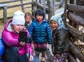 Woman taking Photo of little Children in remote Himalaya Village