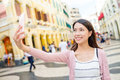 Woman taking photo in Macao Royalty Free Stock Photo