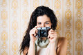 Woman taking photo with old camera hipster photos retro film on vintage ornamental wallpaper Stock Photography