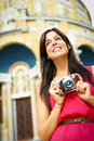Woman taking photos in europe tourist pictures with retro camera while traveling happy tourist pictures Stock Images