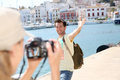 Woman taking photos of her boyfriend on holidays Royalty Free Stock Photo