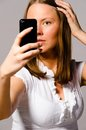 Woman is taking picture of herself Stock Images