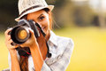 Woman taking pictures attractive young talking outdoors Royalty Free Stock Photography