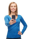 Woman taking self picture with smartphone camera techniology and internet concept smiling Royalty Free Stock Image