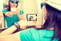 Woman taking self portrait selfie photo smartwatch concept and sends it to Stock Photo