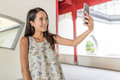 Woman taking selfie in chinese garden Royalty Free Stock Photo