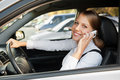 Woman talking on the phone and smiling Royalty Free Stock Photos