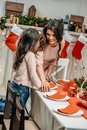 woman talking to her daughter while decorating table Royalty Free Stock Photo