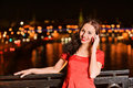 Woman talks on mobile telephone Stock Images