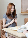 Woman talks with someone sitting at the table Royalty Free Stock Photo