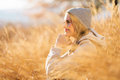 Woman tall grass thoughtful sitting in in autumn Royalty Free Stock Photo