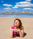 Woman tanning her faces Royalty Free Stock Images