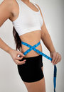 Woman with tape measure fitness Stock Photo